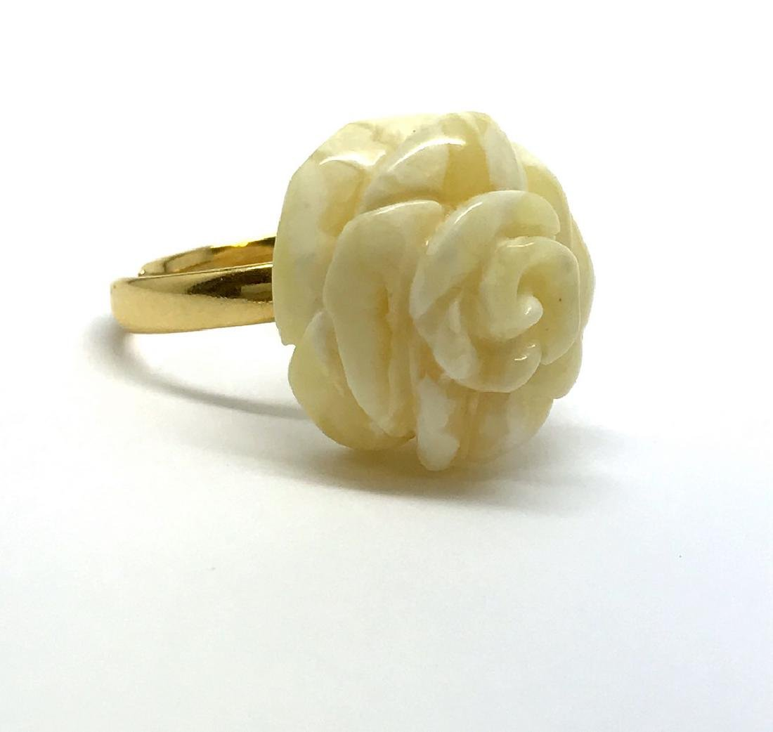 Old silver ring with carved white Baltic amber rose