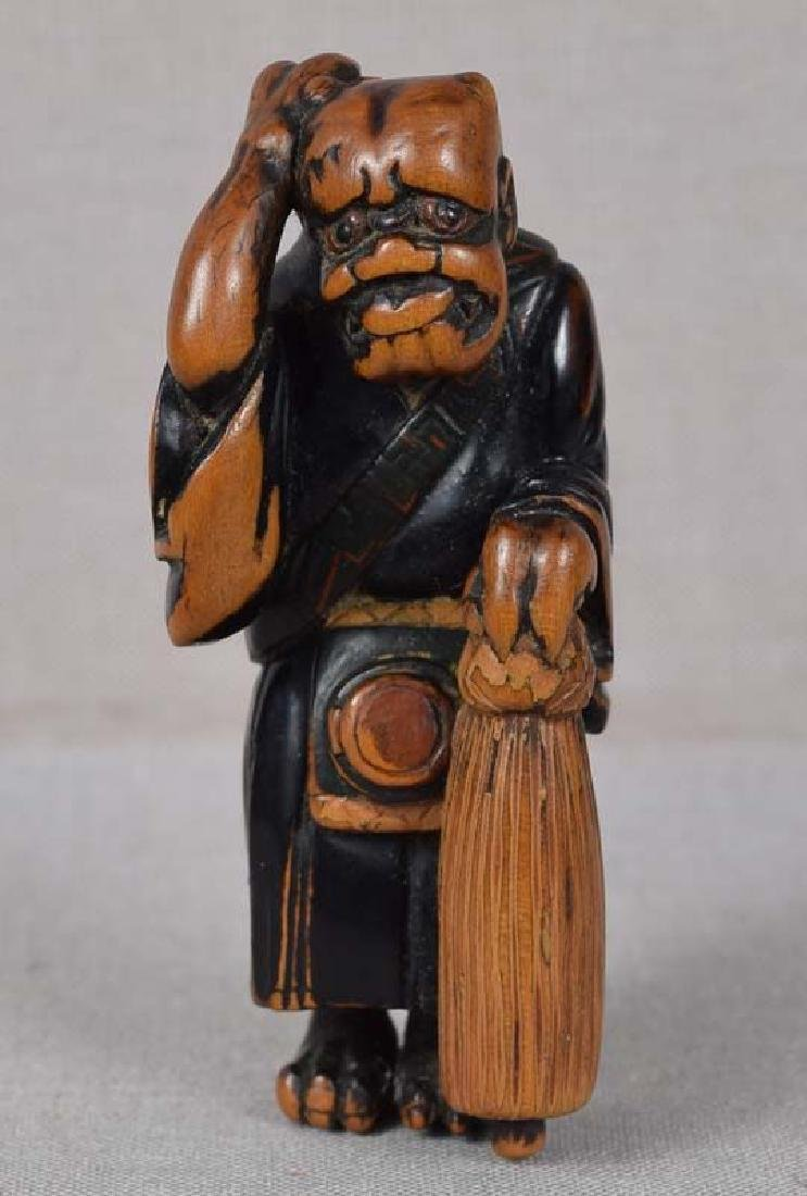 Early 19c netsuke REPENTANT ONI scratching its back