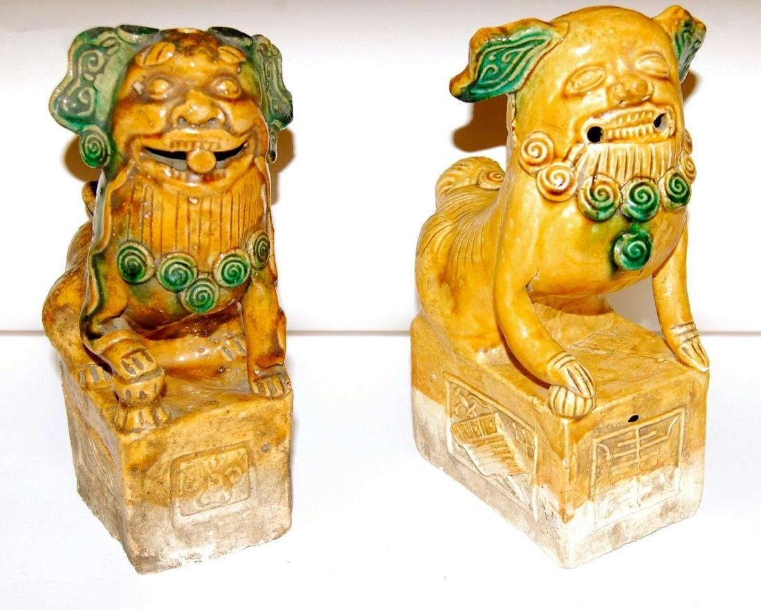 China: Pair of Antique Chinese Pottery Foo Dogs