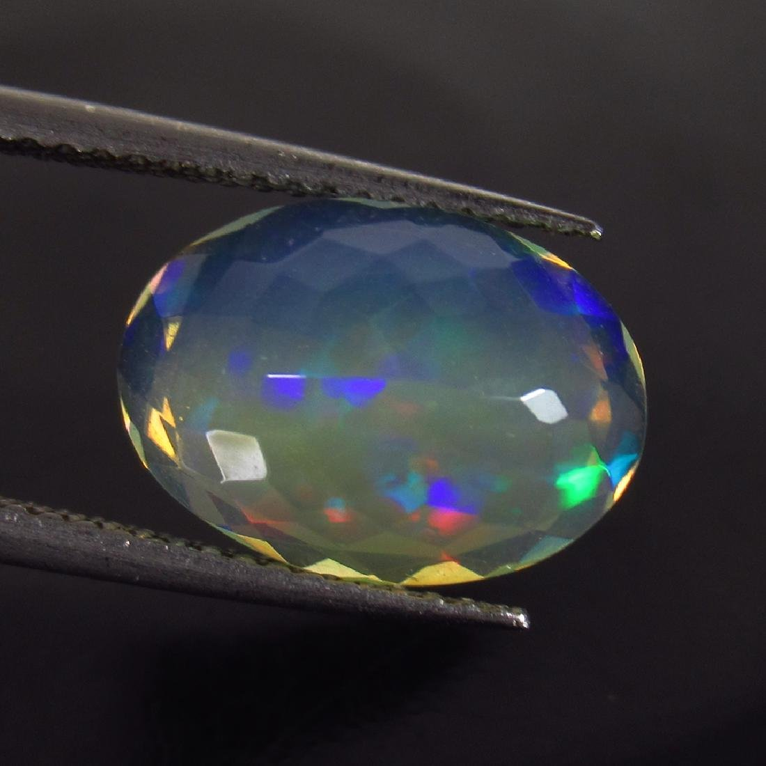 2.88 Ct Genuine Ethiopian Faceted Opal 13X9.5 mm Oval - 2