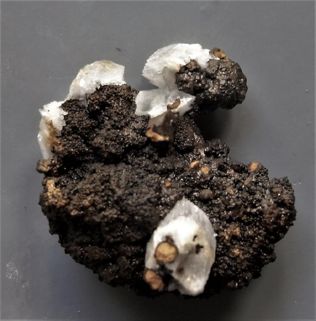GEMMY CALCITE ON SHINY BLACK GOETHITE