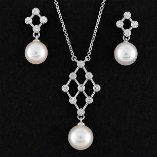 Mikimoto Pearls set in 18K white gold with Round