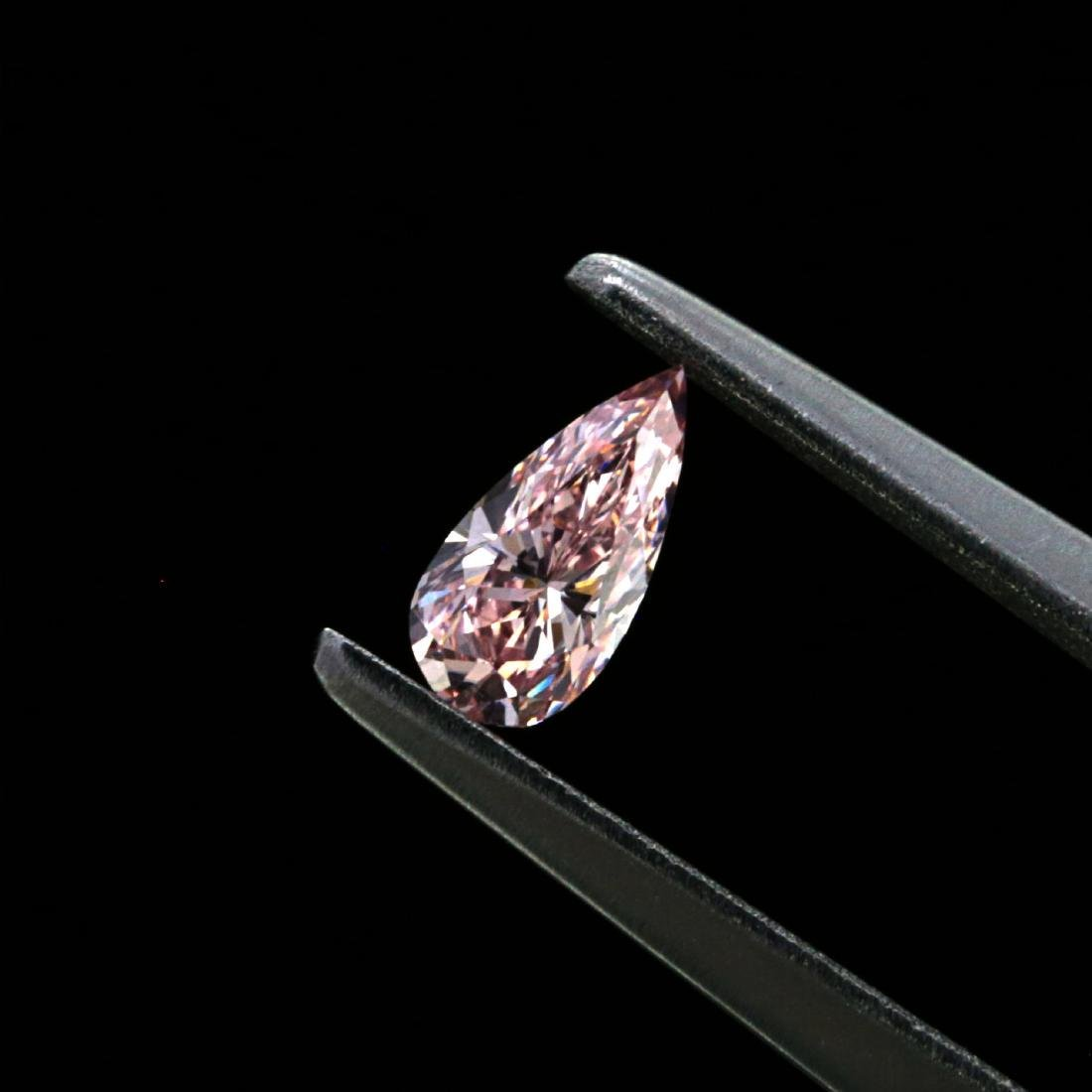 0.20 ct. Natural fancy Orangy Pink Pear shape Diamond,
