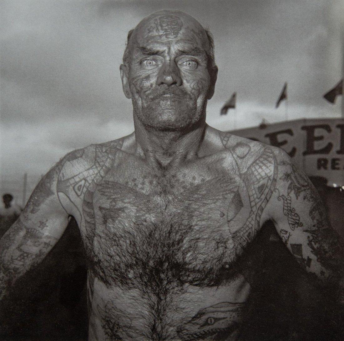 DIANE ARBUS - Tattooed Man at Carnival, MD. 1970