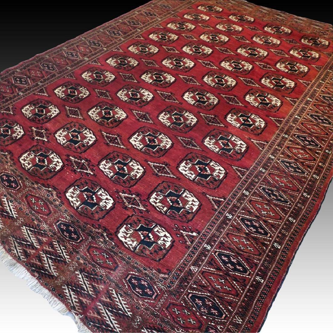10.2 x 7.1 Antique Turkmen Yomut rug - 1920s
