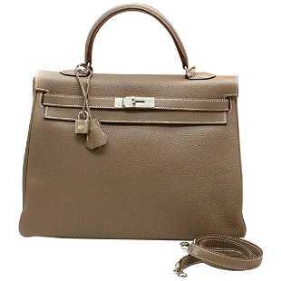 131e5b19ffcb An Hermes black suede miniature Kelly bag, probably