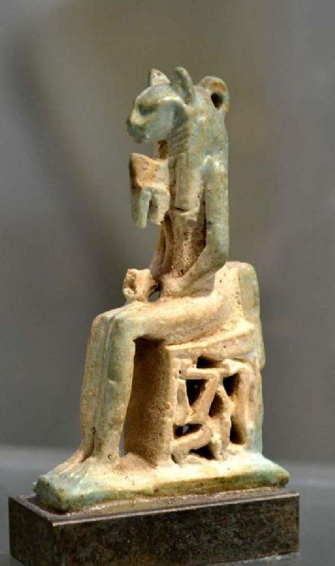 A LARGE FAIENCE SEATED BASTET AMULET