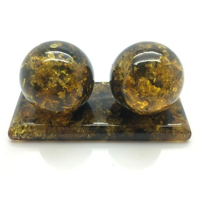 Two baltic amber baoding balls with plate 79,5g