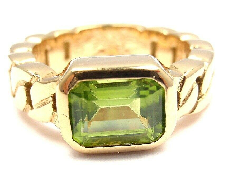 Authentic! CLASSIC CHANEL 18k YELLOW GOLD PERIDOT RING.