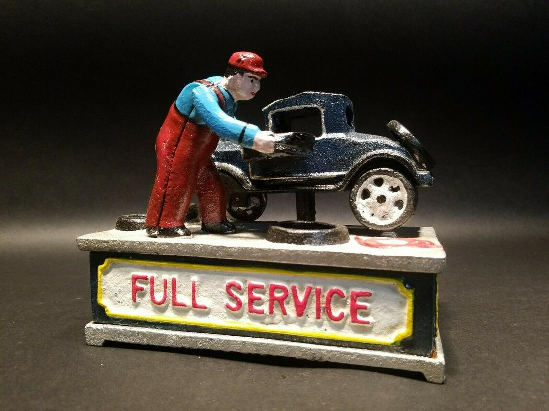 Cast Iron Full Service Mechanical Coin Bank J.E Stevens