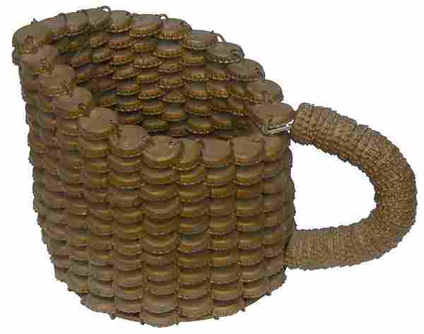 A folk art pitcher made from bottle caps