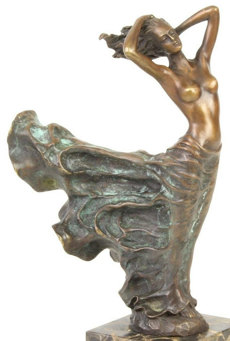 Eclectic bronze artwork of a lady in the wind