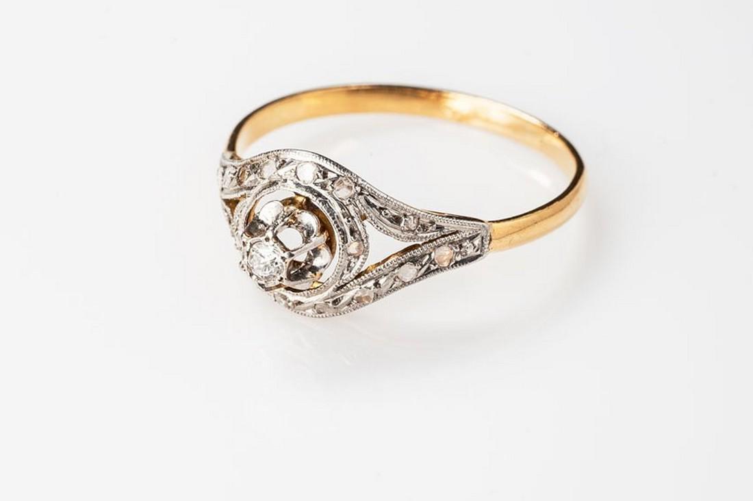18K and plat French tourbillon diamond ring