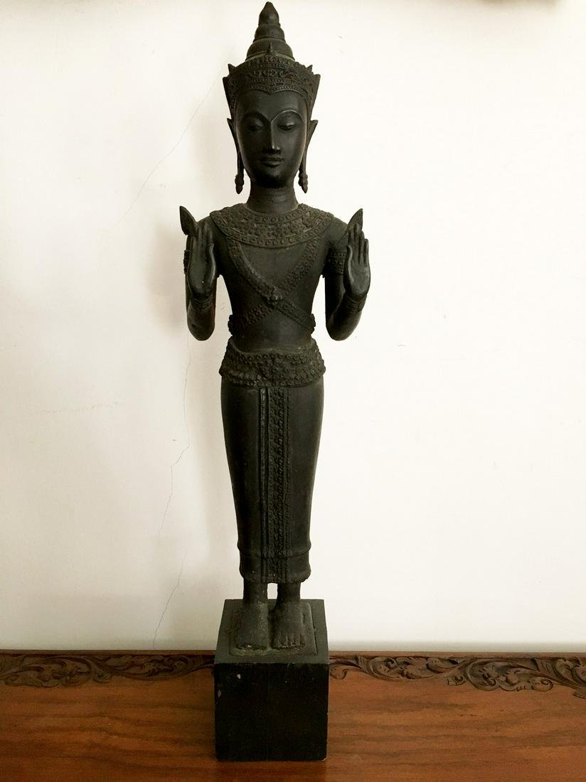 Bronze figurine on a wooden stand
