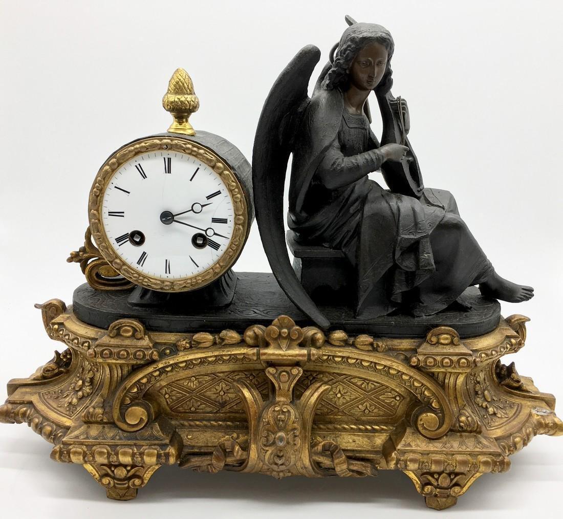 Parcel-Gilt Metal Figural Mantel Clock