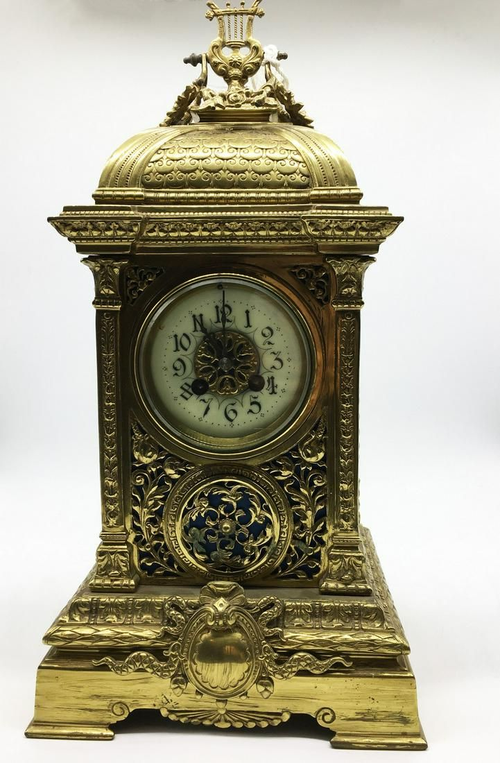 Bronze carriage clock in empire style