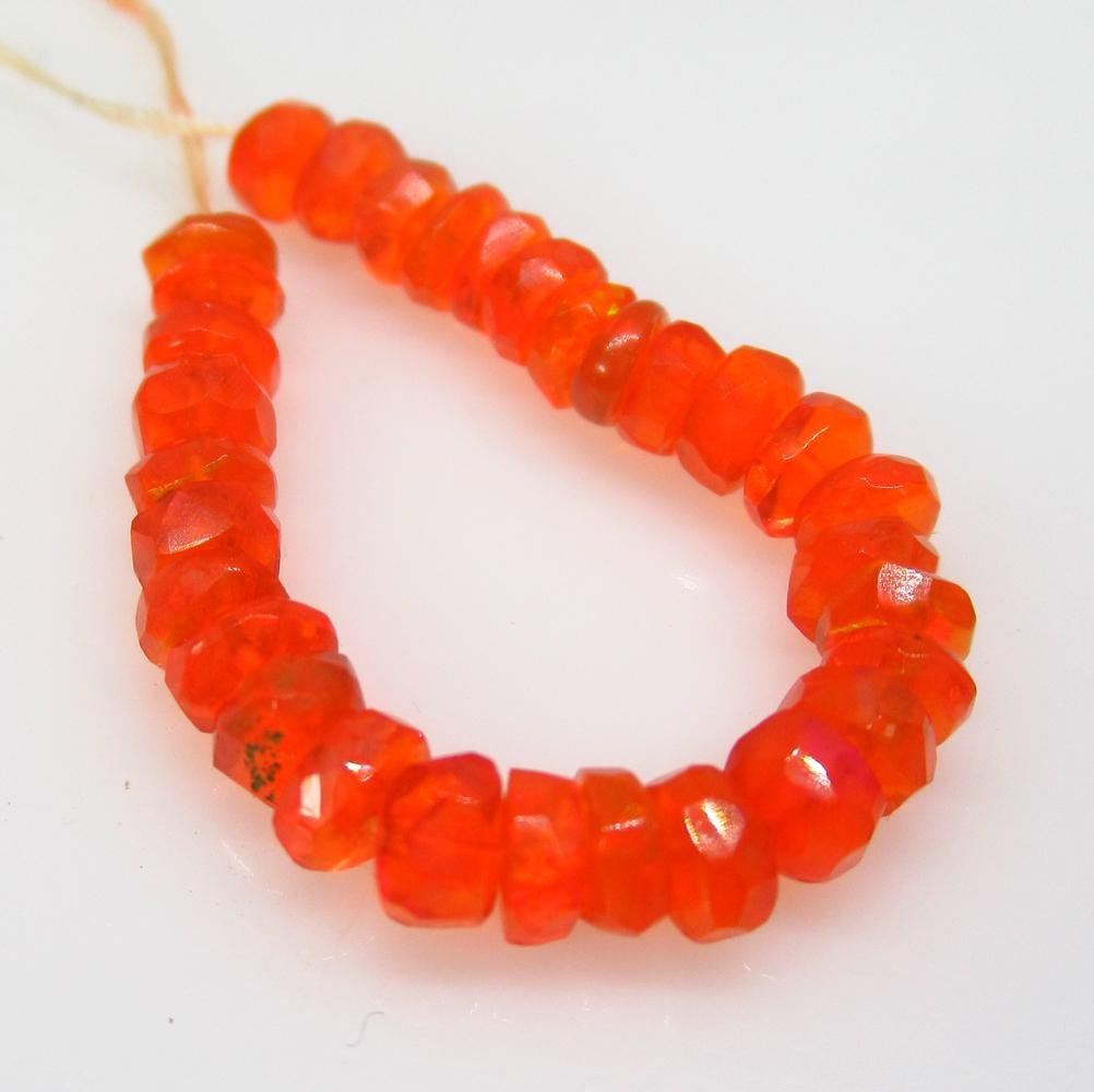 3.85 Ctw Natural 31 Drilled Round Orange Faceted Fire