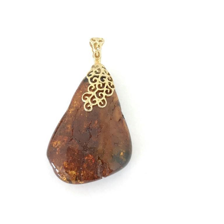 Remarkable Amber Pendant shaped like a Triangle