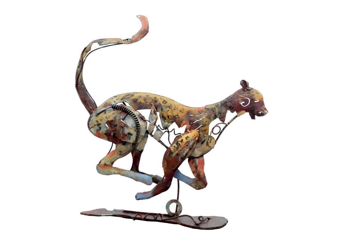 Handmade metal art of a jumping leopard