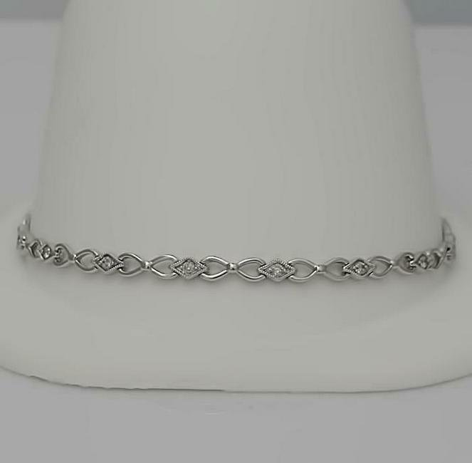 LADIES NEW 10k WHITE GOLD .33ct ROUND DIAMOND INFINITY
