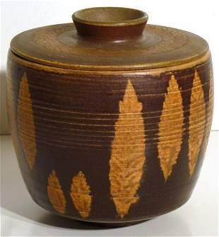 Brown and Tan Pottery jar with a removable lid