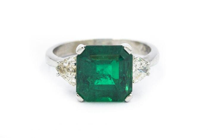 Contemporary Platinum and Colombian Emerald Ring with