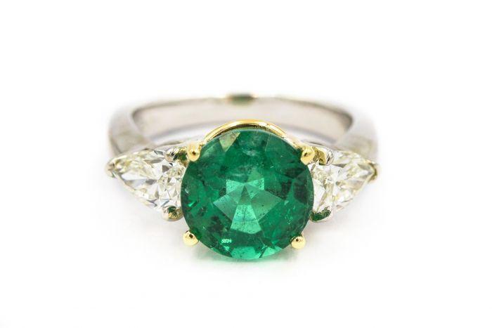 Contemporary Platinum Emerald and Diamond Ring