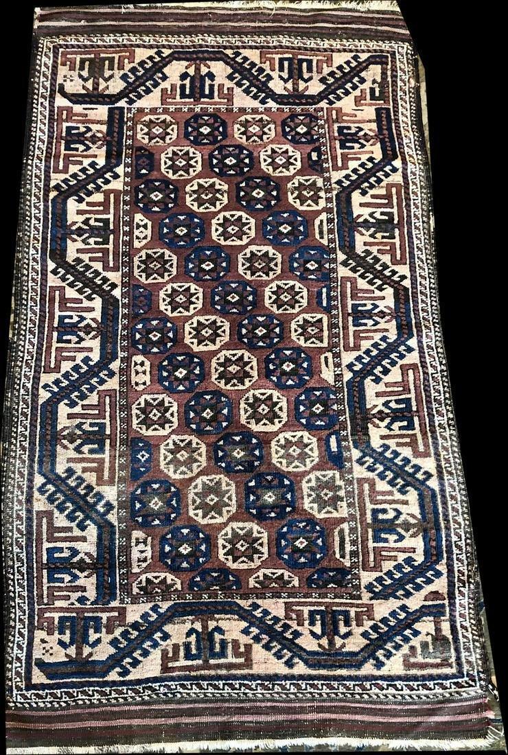 An Interesting Antique Tribal & Primitive Baluch Rug