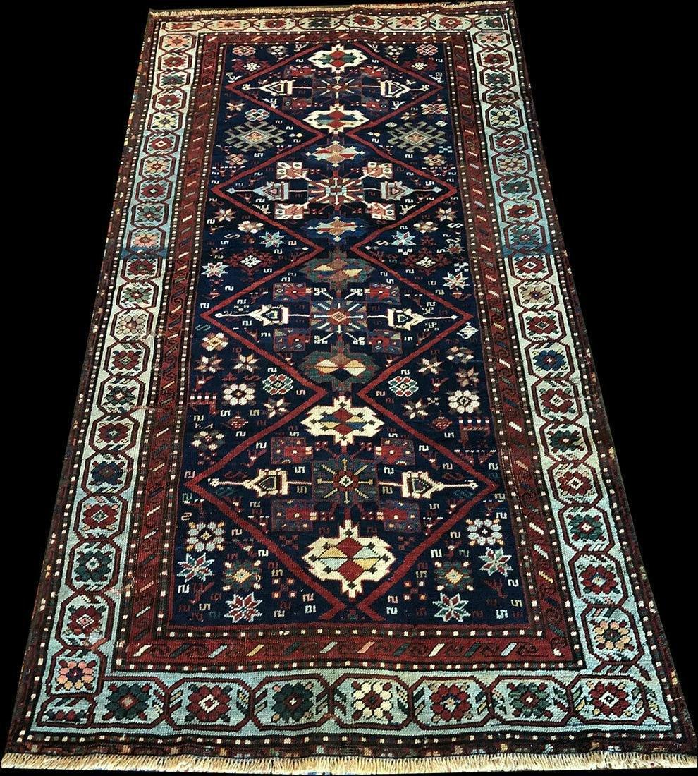 An Antique Caucasian Runner rug