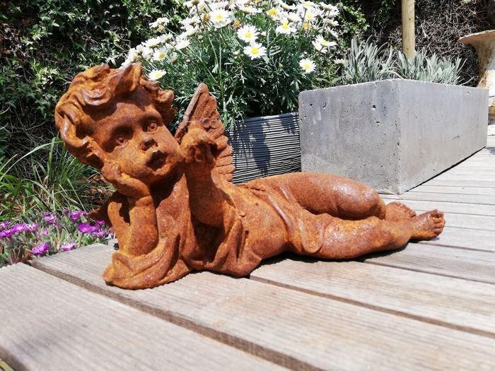 Antique garden sculpture of an Angel (boy)