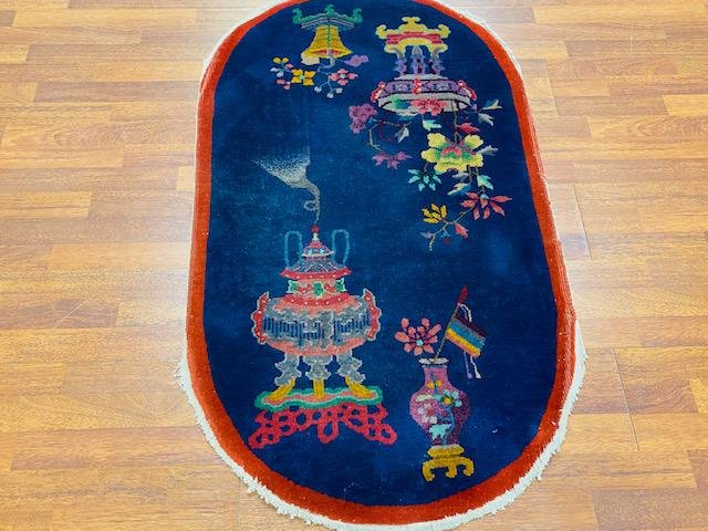 Antique Art deco oval Chinese rug