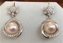 18 kt. Akoya pearl, white gold Earrings with 0.58 ct