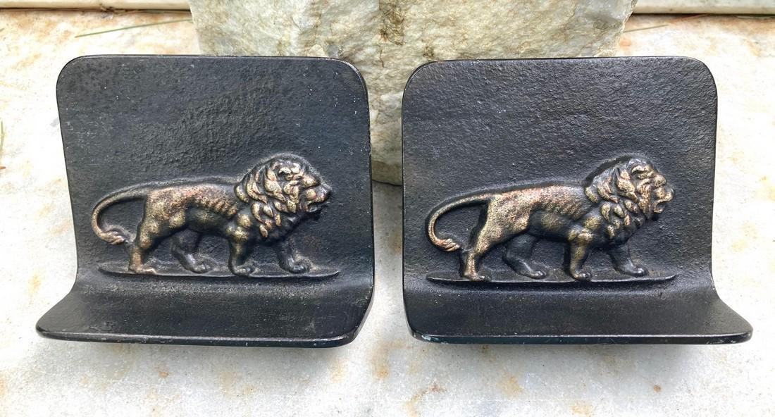 Pr. Early 20thc cast iron lion bookends