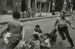 LEONARD FREED - Policewoman Playing with Children