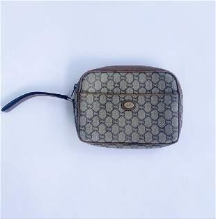 Gucci PVC GG Plus Wristlet