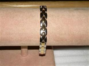Offered for sale is a silver tone with gold tone