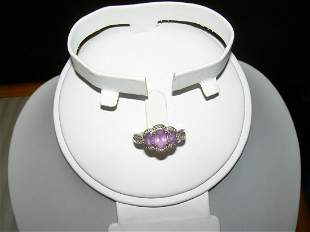 Vintage sterling silver 3 stone amethyst ring has a