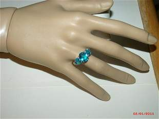 Vintage sterling silver ring is a aquamarine multi