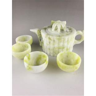 Chinese carved jade teapot and four cups dishes