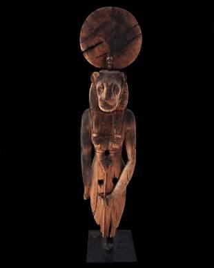 Large Egyptian wooden Sekhmet on a metal base