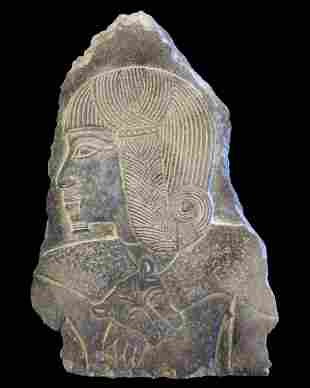 Egyptian granite relief of Ramses II as a child
