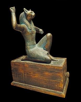 Egyptian bronze Bastet on wooden base with drawer