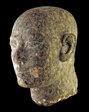Egyptian granite head of a priest