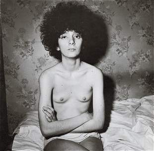 DIANE ARBUS - Girl Sitting on Bed with Shirt Off