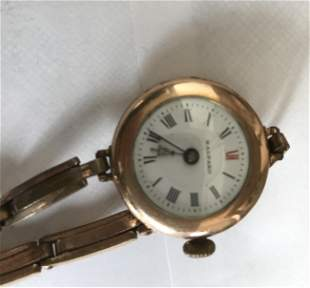 Antique ladies wristwatch with bracelet and enamel dial