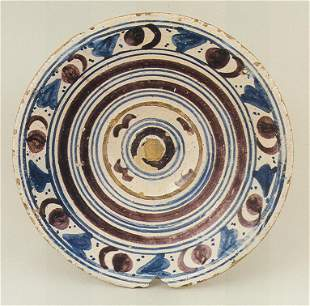 A rare Seville tin glazed charger with geometric