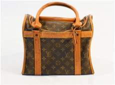 Louis vuitton monogram doggie handbag M42024