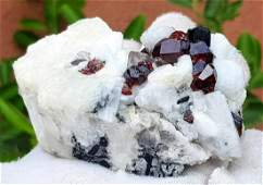 Red Garnet Crystals With Black Tourmaline on Feldspar