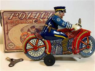 TIN MOTORCYCLE BY LOUIS MARX WITH ORIGINAL BOX AND KEY