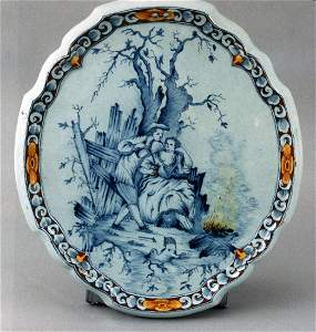 A very fine Dutch delft oval plaque with a raised self
